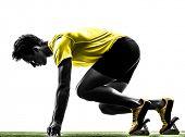 stock photo of sprinter  - one caucasian man young sprinter runner  in starting blocks  silhouette studio  on white background - JPG