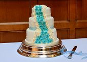 picture of three tier  - a blue and cream modern wedding cake - three tiers