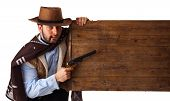 image of gunslinger  - Gunman in the old wild west with studio lighting - JPG