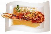 pic of lobster tail  - Grilled lobster tail served in a sauce isolated on white background - JPG