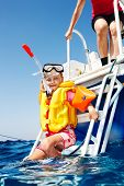 Happy family with child on yacht. Snorkeling travel.