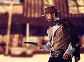 foto of gunslinger  - Bad gunslinger in the old wild west - JPG