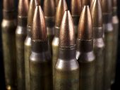 stock photo of ak47  - Rifle Bullets closeup on isolated  black backgrounds - JPG