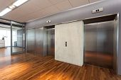 stock photo of elevator  - Office interior and hall with two elevators - JPG