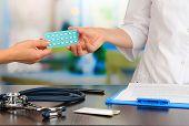 foto of gynecologist  - Gynecologist appoints hormone pills patient - JPG