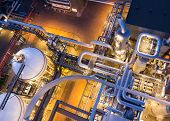 stock photo of valves  - piping system in industrial plant from above - JPG