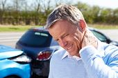 stock photo of injury  - Driver Suffering From Whiplash After Traffic Collision - JPG
