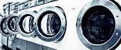 picture of laundromat  - industrial washing machines in a public laundromat - JPG