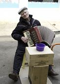 foto of accordion  - The old man plays the accordion - JPG
