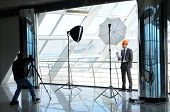stock photo of pro-life  - A photographer shoots architect in office building - JPG