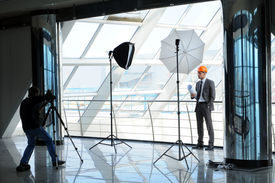 foto of pro-life  - A photographer shoots architect in office building - JPG