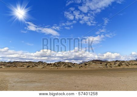 Sand Hills And Blue Sky With Clouds