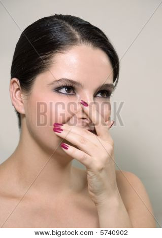Woman covering her face with fingers