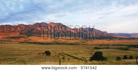 Mountains On The Edge Of The Prairie At Sunrise