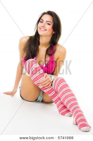 Young Woman In Pink Vivid Clothes With Big Smile Sit On The Floor,look At Camera