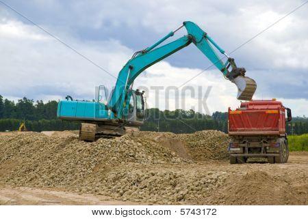 Excavator loading  rocks in lorry