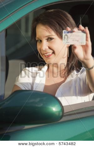 Happy Woman Showing Driving License
