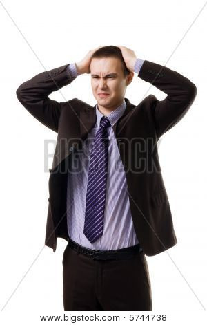 Very Upset Young Man Holding Head With Hands Wearing Formal Suit