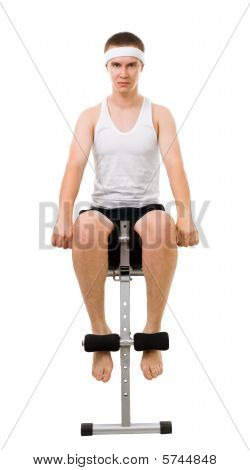 Young Man Do Fitness, Sitting On Bench For Abdomen Muscles