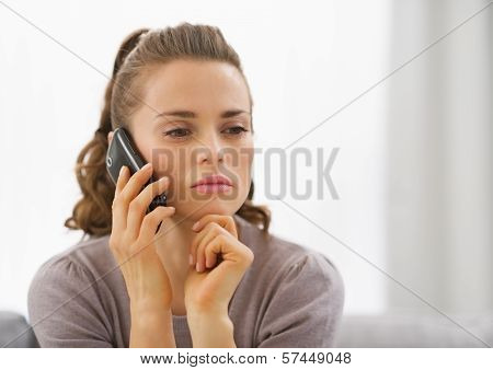 Concerned Young Woman Talking Cell Phone