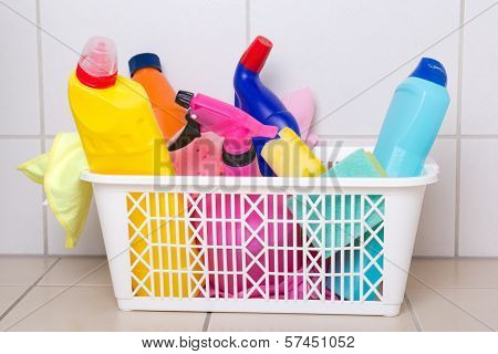 Cleaning Supplies In Plastic Box On Tiled Floor