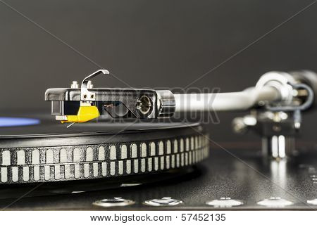 Phonograph Cartridge Waits Over Turntable