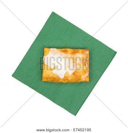 Toasted Pastry With Icing On A Napkin
