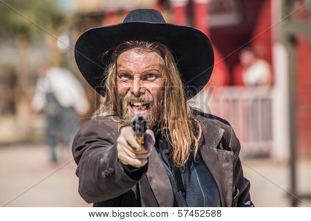 Cowboy Points Gun At You