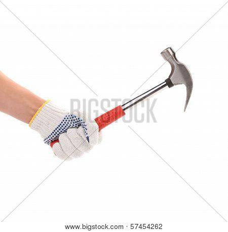 Hand holding metal hammer.