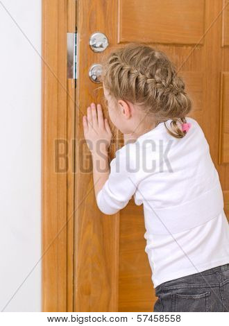 Little Girl Opening Door To Someone.
