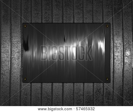 Metal Background with metal nameplate for writing.