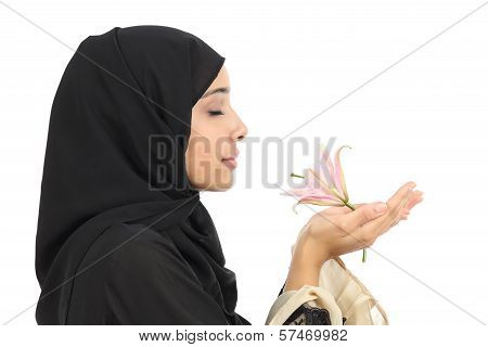 Close Up Of A Profile Of An Arab Woman Smelling A Flower