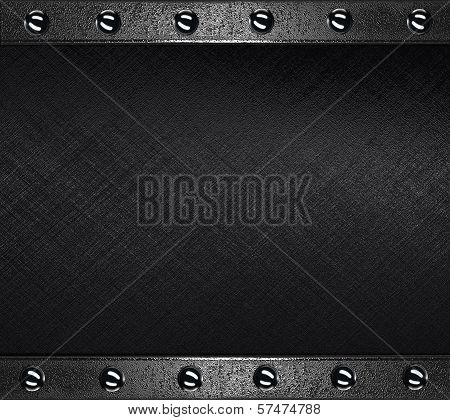 Black Background with metal plates at the edges with rivets.