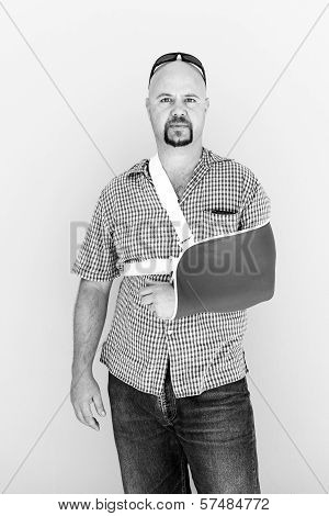 Young Male With His Broken Arm In A Sling