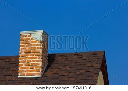 The Brick Chimney In Bright Sunlight A Deep Blue Sky Horizontal
