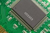 pic of microprocessor  - Large and small microprocessor components on the circuit board green - JPG