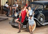 picture of gangster necklace  - 1920s vintage gangster women holding weapons near car