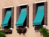 stock photo of awning  - Three windows with blue - JPG