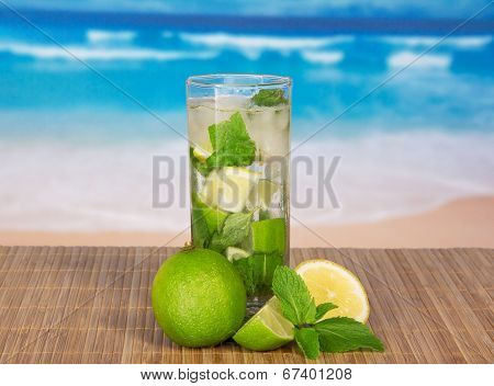 Glass with mojito, juicy lime and spearmint