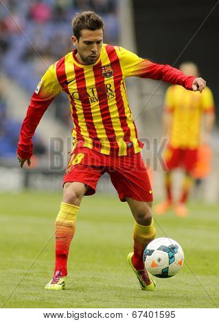BARCELONA - MARCH, 29: Jordi Alba of FC Barcelona in action during a Spanish League match against RCD Espanyol at the Estadi Cornella on March 29, 2014 in Barcelona, Spain