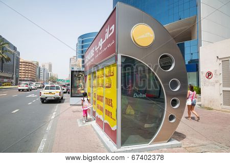 DUBAI, UAE - MARCH 31: Air-conditioned bus station in Dubai on March 31, 2014, UAE. Roads and Transport Authority (RTA) system has 193 routes and transports over 30 million people weekly in Dubai.