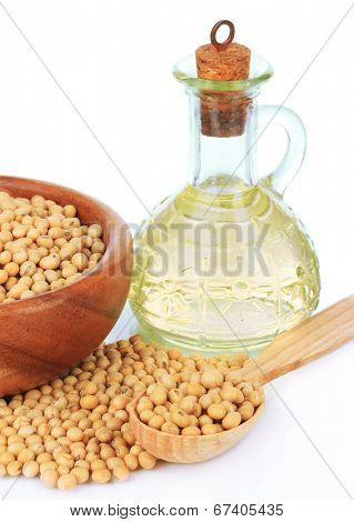 Soy beans and oil isolated on white