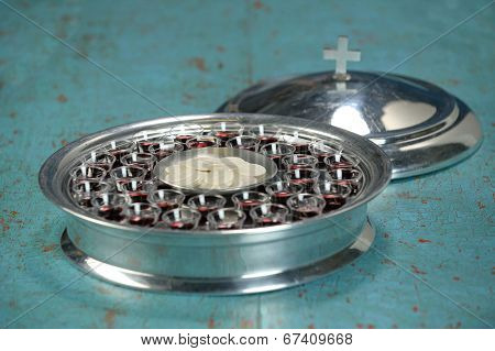 Communion tray with wafers and wine cups - Shallow depth of field on tray