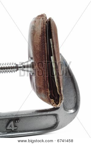 Old Worn Wallet Being Squeezed In A C Clamp