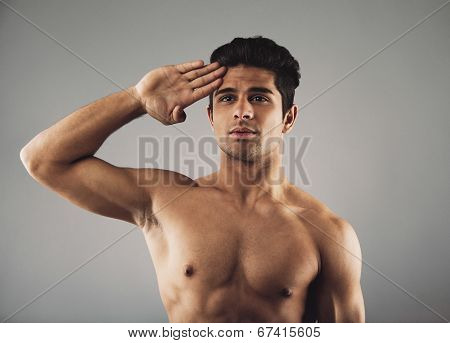 Strong Muscular Guy Giving A Salute
