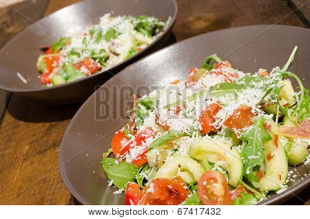 Arugula Salad With Tomatoes, Olives And Parmesan
