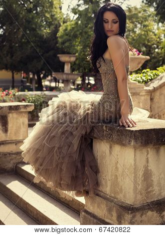 Beautiful Woman In Luxurious Dress Posing At Summer Park