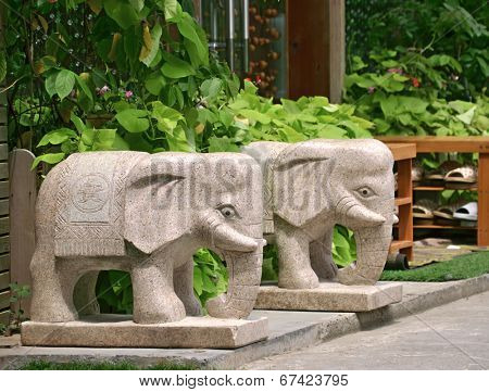 Stone elephant sculpture at the door