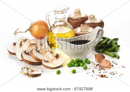 Fresh Mushrooms And Vegetables Ingredients On White Background