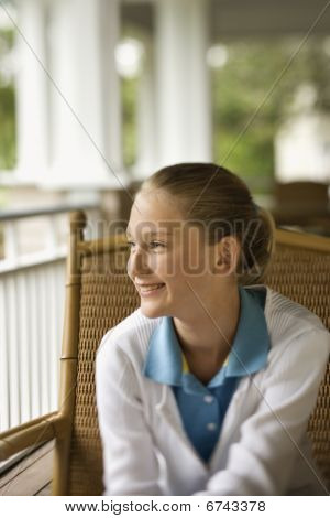 Young Girl On Porch Smiling